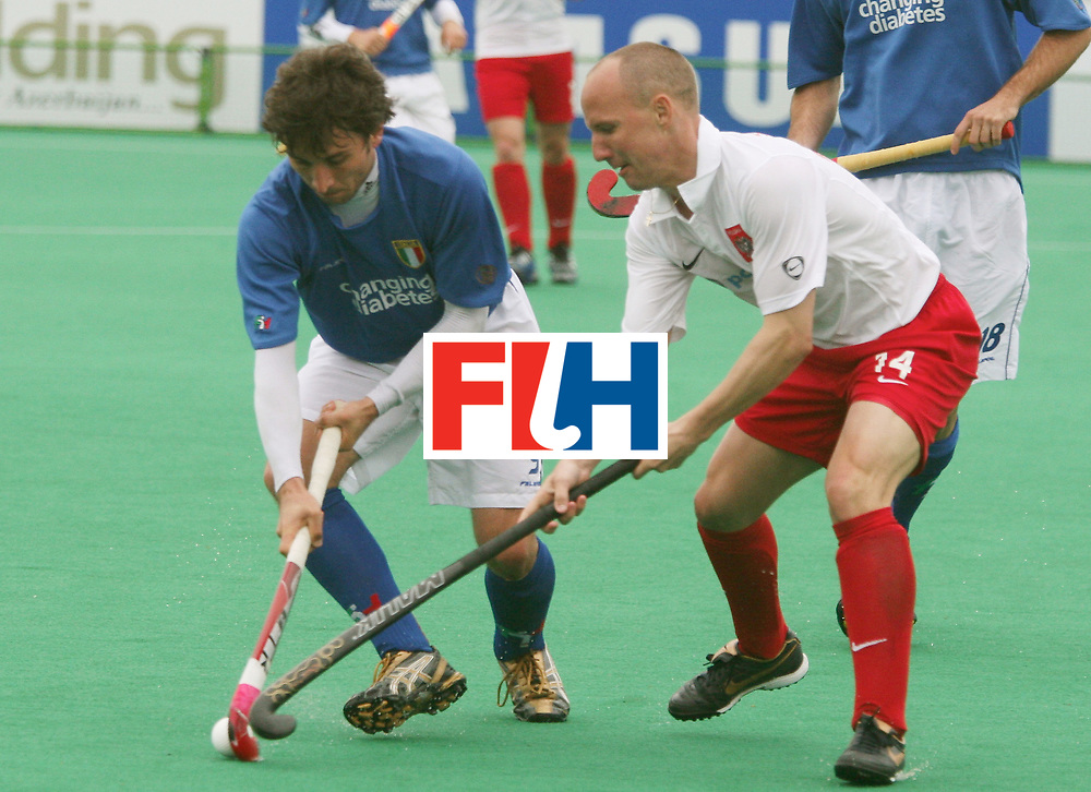 Kakamigahara (Japan): The Polish and the Italian vying for the ball in the Olympic Hockey Qualifier match at Gifu Perfectural Green Stadium at Kakamigahara on 10 April 2008. Poland beat Italy 6-0.<br /> Photo: GNN/ Vino John