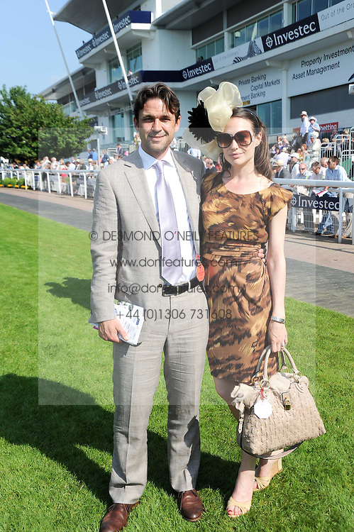 DOUGRAY SCOTT and CLAIRE FORLANI at the Investec Ladies Day at Epsom Racecourse, Surrey on 4th June 2010.