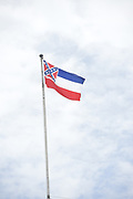 6/29/2020 Jackson MS.<br /> Pictured is the Mississippi State flag flying over the State Capitol one day after the Legislature voted to remove the Confederate symbol after 126 years. The Congressional Black Caucus held a press conference in the shadow of the Confederate flag,  on the Capitol steps in regard to the historic vote to remove the Confederate flag. After 126 years the Confederate Flag is finally coming down.  The Mississippi Black Caucus expressed what a historic day this was for the State of Mississippi. They also stated how it was past time to remove the racist symbol from the state flag. The MS House of Representatives passed the Bill 91-23 and the MS Senate voted 31-14 in favor of changing the flag. The Bill would allow for the redesign of the Mississippi State Flag, the current flag has the Confederate symbol on it. Mississippi is the last State in the Nation to still have the stars and bars of the Confederate symbol on its state flag.  Governor Tate Reeves said he would sign it if it passed the State is now waiting for his signature on HB1796. Photo © Suzi Altman @suzialtman #mississippi #history #change #flag #confederateflag    #ms #blackcaucus #racism #BLM #equality