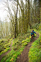 Mountain biking the Wilson River Trail near Tillamook, Oregon.