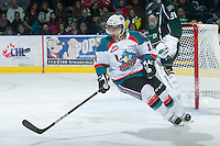 KELOWNA, CANADA - DECEMBER 30: Dylen McKinlay #19 of the Kelowna Rockets skates on the ice against the  Everett Silvertips at the Kelowna Rockets on December 30, 2012 at Prospera Place in Kelowna, British Columbia, Canada (Photo by Marissa Baecker/Shoot the Breeze) *** Local Caption ***