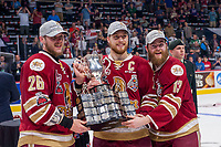 REGINA, SK - MAY 27: Jeffrey Truchon-Viel #25 of Acadie-Bathurst Titan is presented with the Memorial Cup by CHL president David Branch at the Brandt Centre on May 27, 2018 in Regina, Canada. (Photo by Marissa Baecker/CHL Images)