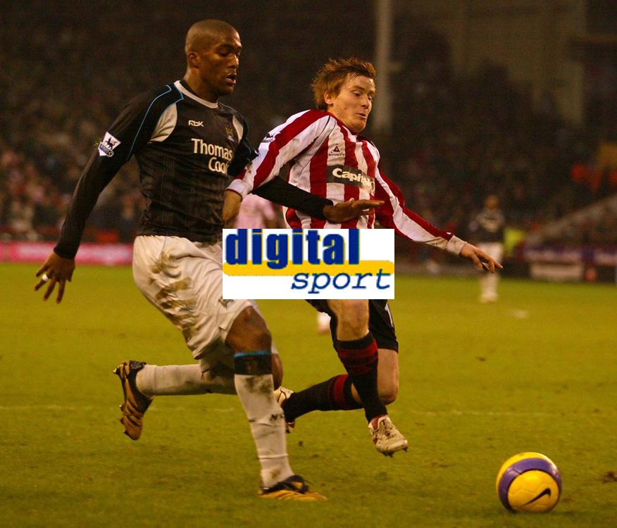 Photo: Aidan Ellis.<br /> Sheffield United v Manchester City. The Barclays Premiership. 26/12/2006.<br /> Sheffield's Rob Kozluk (R) tries to nip in front od City defender Sylvain Distin