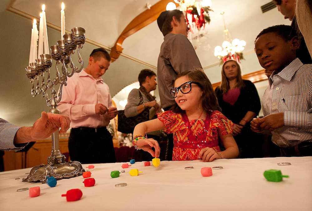 Lucy Sophia Wallin and Jackson Price, Ambassador John Price's grandchildren,  try their hands at spinning dreidels during the menorah lighting ceremony at the Governor's Mansion on the fourth night of Chanukah 2012, Tuesday, Dec. 11, 2012.
