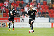 Brentford  midfielder Lewis Macleod (4)  comes away with the ball during the EFL Sky Bet Championship match between Rotherham United and Brentford at the New York Stadium, Rotherham, England on 20 August 2016. Photo by Simon Davies.
