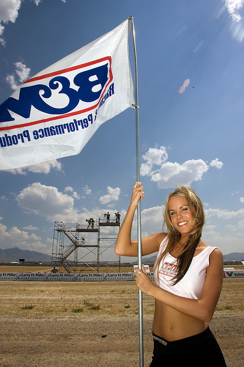 Hillary Pratt of Tooele holds up a flag for BMW prior to the start of a race at the Larry H. Miller Motor Sports Park in Tooele, Utah July. 15, 2006.