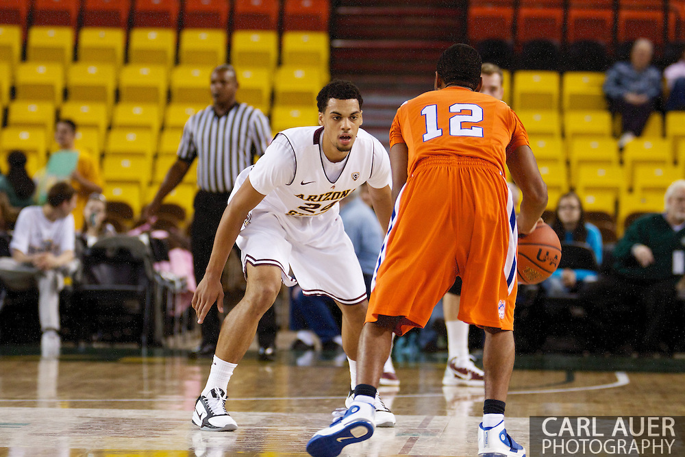 November 25th, 2010:  Anchorage, Alaska - Arizona States Trent Lockett (24) sets up on defense against Houston Baptist guard Michael Moss (12) in the Sun Devils 73-55 win over Houston Baptist in their first round game of the Great Alaska Shootout.