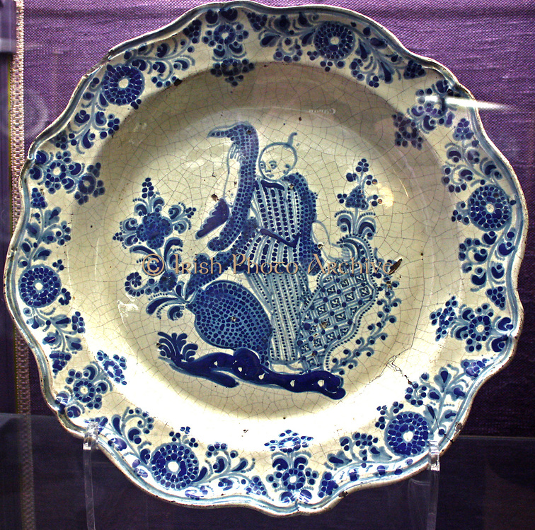 Plate, painted with a Chinese figure, tin-glazed earthenware.  Mexican, Pueble, about 1750-1820.