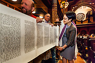 Central Synagogue's senior rabbi Angela Buchdahl unrolls the scroll at a Simchat Torah service