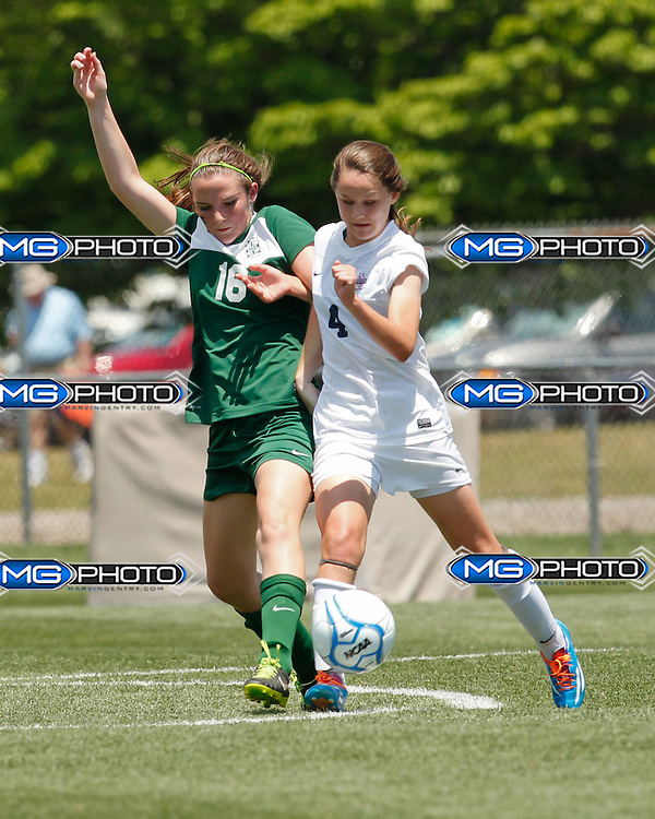 May 10, 2014; Huntsville, AL, USA;  Mountain Brook Nicole Strahl (16) and Oak Mountain Julia Marie Pack (4) struggle for the ball during the 6A State Girls Soccer Championship at John Hunt Soccer Complex.Mandatory Credit: Marvin Gentry