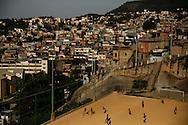 Children play soccer during a soccer classes at the Sao Carlos slum in Rio de Janeiro May 22, 2014. Photo/Pilar Olivares (BRAZIL)
