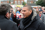 Ex-Forest player Stan Collymore is interviewed during Nottingham Forest fans stage a peaceful demonstration to show their frustration against Forest chairman Fawaz Al-Hasawi ahead of the EFL Sky Bet Championship match between Nottingham Forest and Bristol City at the City Ground, Nottingham, England on 21 January 2017. Photo by Jon Hobley.
