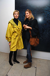 Left to right, VICTORIA, LADY DE ROTHSCHILD and TANIA DE ROTHSCHILD at the launch of Ecuador: Block 16 a partnership between IWC watches and David De Rothschild held at The Hospital, Endell Street, Covent Garen, London on 8th October 2007.<br />