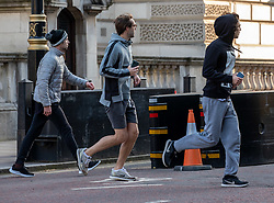 © Licensed to London News Pictures. 24/03/2020. London, UK. A group of 3 runners seen in Westminster as Prime Minister Boris Johnson orders a police enforced lock-down on the UK as people are banned from leaving home except for food, medical reasons, exercise and essential work as the coronavirus crisis continues. Photo credit: Alex Lentati/LNP