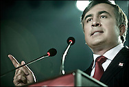 """President Mikhail Saakashvili speaking to is supporters in the Sport Palace in Tbilisi, Georgia on 04 January, 2008 on the day before the Presidential Elections. Saakashvili was elected president in January 2004. OSCE observers described the vote as a """"welcome contrast"""" to a rigged parliamentary poll the previous November. Mr Saakashvili had led the ''Rose Revolution'' protests which followed that election, forcing his predecessor as president, Eduard Shevardnadze, to resign. Soon after that, Mr Saakashvili consolidated his position when his National Movement-Democratic Front won parliamentary elections. It holds the majority of seats and opposition representation is extremely weak. However, after last months protests of the opposition, that were violently stopped by the police, several parties expect that there will be again demonstrations organized by the (pro Russian) opposition if Saakashvili will win the elections held on January 5. **FRANCE NEWSPAPERS OUT UNTIL JANUARY 6, 2008**"""