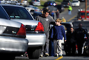 As early reports indicate two people, including a shooter, are dead, parents are reunited with their children at a staging area at the end of the entrance of the Sandy Hook Elementary School at a firehouse in Newtown, Conn. (AP Photo/Jessica Hill)