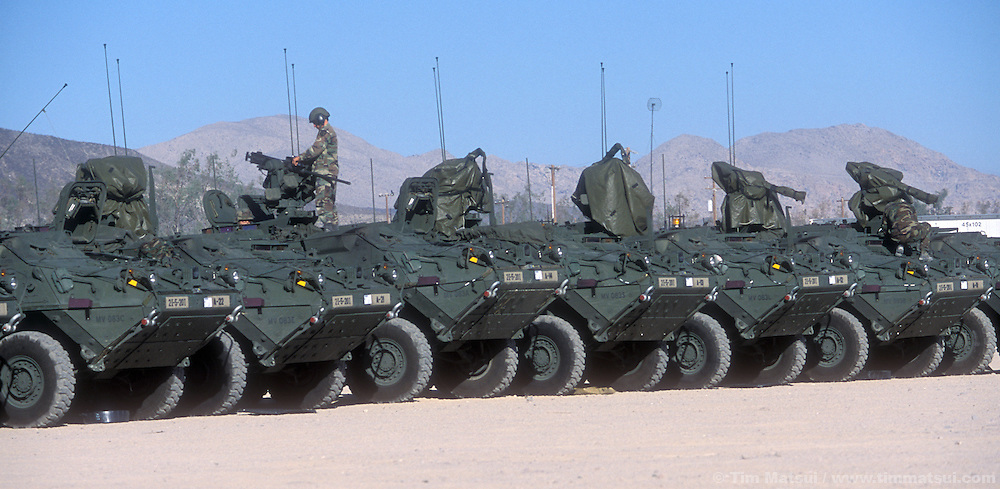 The Army's new Stryker medium weight armored vehicle,  at the National Training Center in Ft. Irwin, Calif. on Friday, July 26, 2002. The army has only had the Stryker for a month and this is their debut in maneuvers at 'war' at Ft. Irwin for the Millennium Challenge 2002 Experiment (MCO2)...The Stryker has a communictions package, called the FBCB2 that enables them to transmit and receive data on their position, the position of other FBCB2 equiped vehicles, still shots from unmanned aerial vehicles, and data from higher command. This will help improve their intelligence knowledge and share in real time with other units...As part of the military transformation MC02 is testing all branches of the military in the largest ever live and virtual battle being played out across the nation through August 15, 2002. The goal is to see how well the different branches operate together under a joint command that shares intelligence and resources in an effort to put the right forces in the right place at the right so as to minimze the amount of fighting that is necessary to protect U.S. interests abroad.