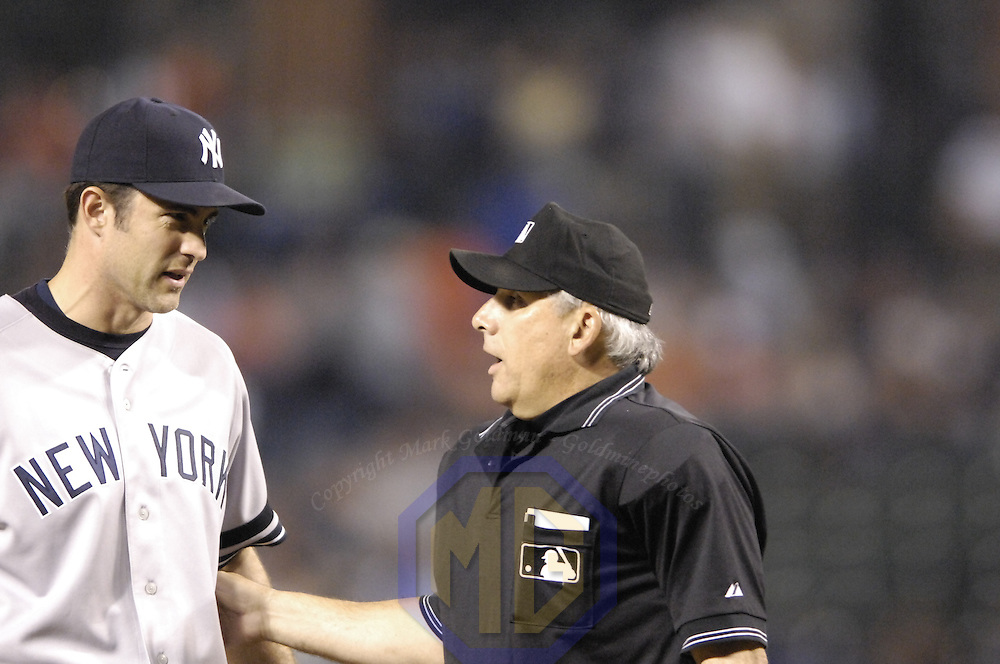 28 September 2007:  Umpire Larry Vanover talks with New York Yankees pitcher Mike Mussina (35) during the game between the New York Yankees and the Baltimore Orioles.  The Orioles defeated the Yankees 10-9 in ten innings at Camden Yards in Baltimore, MD.  ****For Editorial Use Only****