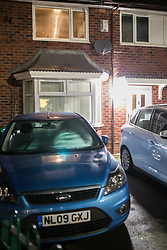 © Licensed to London News Pictures .  24/01/2018 . Manchester , UK . GV of a house (pictured with white door and cars on driveway) on Somerton Avenue in Wythenshawe where on the afternoon of Sunday 21 January 2018 police report being called by the ambulance service to reports that a 22-month-old girl was having a medical episode . This evening (January 24 2018) police have arrested a 34-year-old woman and a 28-year-old man on suspicion of murder in relation to the girl's death . Photo credit : Joel Goodman/LNP
