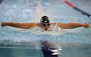 Moss Burmester races in the Men's 200m Butterfly at the at the New Zealand Swimming World Championship Trials at the West Aquatic Centre, Auckland, New Zealand, on Saturday 16 December 2006. Photo: Hannah Johnston/PHOTOSPORT<br /> <br /> <br /> 161206