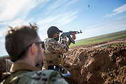 KURDISTAN, NORTHERN IRAQ, Dokuk.<br /> Qalubna Ma'Kum Feature:<br /> Qalubna Ma'kum (meaning &quot;Our hearts are With You&quot;) are a group of foreign volunteer fighters who have joined up with the Peshmerga in Kurdistan to help with the battle against Daesh, also known as ISIS. <br /> <br /> Pictured: French volunteer and co-founder of Qalubna Ma'kum Francis Cuvelier (front) trains a new volunteer , also from France.