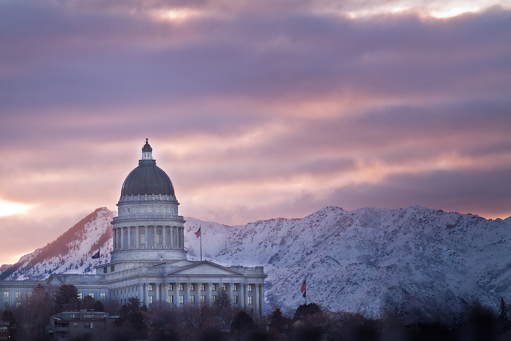 Utah State Capitol building against the early morning sky.