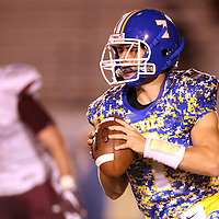 Lauren Wood   Buy at photos.djournal.com<br /> Booneville quarterback Preston Stroupe looks to pass downfield during Friday night's game at Booneville.