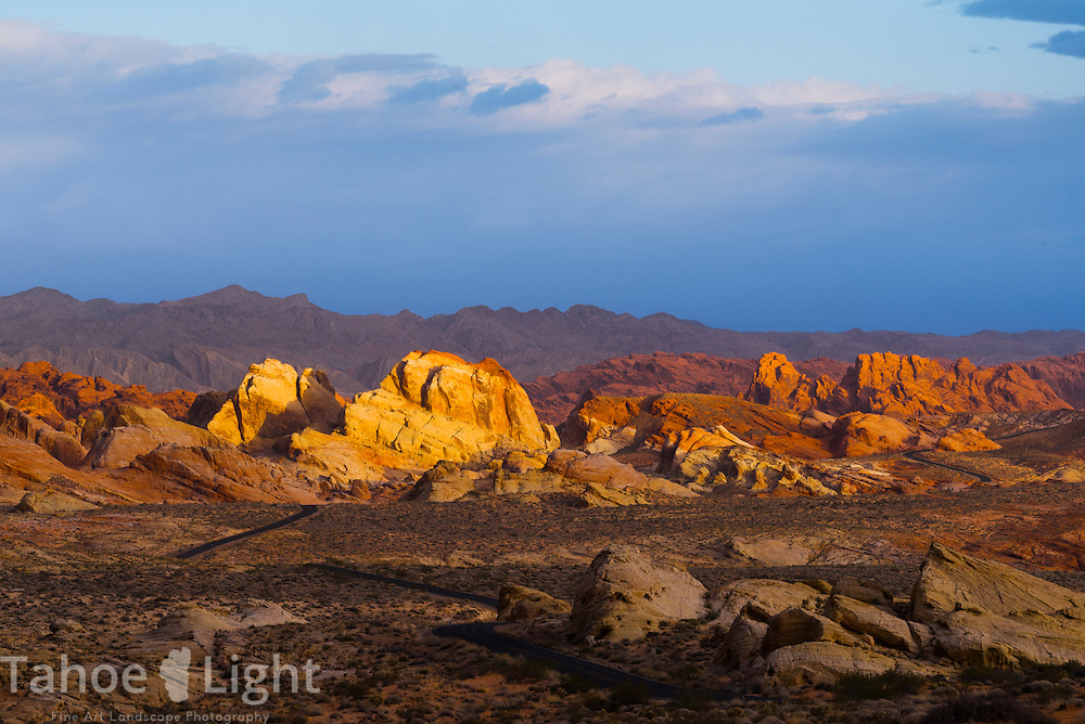 Morning storm light on the colorful petrified sand dunes that create the unique landscape of Valley of Fire state park in Southern Nevada about 2 hours outside of Las Vegas.
