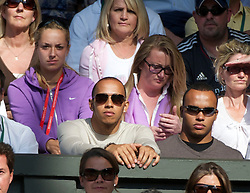 LONDON, ENGLAND - Wednesday, June 29, 2011: Formula one race driver Lewis Hamilton and half-brother Nicolas, with tennis player Sabine Lisicki behind, during the Gentlemen's Singles Quarter-Final match on day nine of the Wimbledon Lawn Tennis Championships at the All England Lawn Tennis and Croquet Club. (Pic by David Rawcliffe/Propaganda)