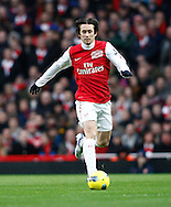 Picture by Andrew Tobin/Focus Images Ltd. 07710 761829. .21/01/12. Tomas Rosicky (7) of Arsenal on the ball during the Barclays Premier League match between Arsenal and Manchester United at Emirates Stadium, London.