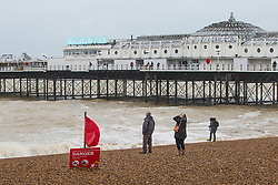 © Licensed to London News Pictures. 31/12/2017. Brighton, UK. Members of the public take advantage of a break in the rain to spent some time on the beach in Brighton and Hove on 2017 New years eve. Photo credit: Hugo Michiels/LNP