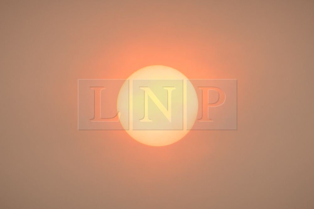 © Licensed to London News Pictures. 16/10/2017. Southsea, UK.  The orange glow of the sun seen this afternoon behind a thick blanket of yellow and orange cloud. Widespread areas of Southern and South Eastern England experienced light levels similar to those at dawn and dusk with the sky turning yellow and orange. Photo credit: Rob Arnold/LNP