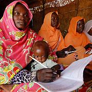 Sudan, Darfur - El Geneina. Al Ryad camp &ndash; Women&rsquo;s Centre<br /> Women's literacy class student Haja Abdul Karim with her baby son.