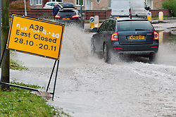© Licensed to London News Pictures. 16/11/2019. Tewkesbury, Worcestershire, UK. Motorists drive through a floods on the outskirts of Tewkesbury in Worcestershire. Many roads around Tewkesbury are seriously flooded. After several days of heavy rainfall, there is severe flooding in many parts of  Worcestershire, UK. Levels are expected to peak this afternoon.  Photo credit: Graham M. Lawrence/LNP