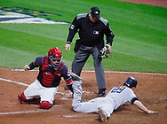 October 11, 2017 - Cleveland, OH, USA - The New York Yankees' Todd Frazier slides safely ahead of the tag from Cleveland Indians catcher Roberto Perez, left, as he scores on a two-run single by Brett Gardner in the ninth inning during Game 5 of the American League Division Series, Wenesday, Oct. 11, 2017, at Progressive Field in Cleveland. The Yankees advanced with a 5-2 win. (Credit Image: © Leah Klafczynski/TNS via ZUMA Wire)