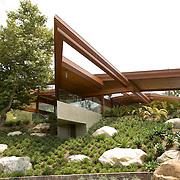 Norm Applebaum designed the Brandes residence in Rancho Santa Fe, California in 2006. It's a mid-century modern temple - approximately 50,000 square feet, atop a thirty car garage. The garage is full.