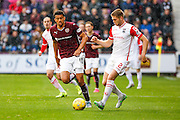 Ross County Defender Marcus Fraser and Hearts FC Forward Osman Sow battle during the Ladbrokes Scottish Premiership match between Heart of Midlothian and Ross County at Tynecastle Stadium, Gorgie, Scotland on 24 October 2015. Photo by Craig McAllister.