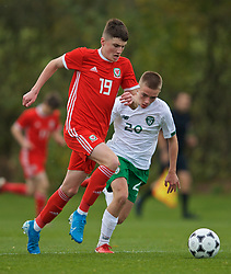 WREXHAM, WALES - Wednesday, October 30, 2019: Wales' Joel Cotterill (L) and Republic of Ireland's Corey McLoughlin during the 2019 Victory Shield match between Wales and Republic of Ireland at Colliers Park. (Pic by David Rawcliffe/Propaganda)