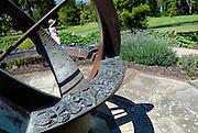 Child (6 years old) strolling near Herb Garden Sundial. Royal Botanic Gardens, Sydney, Australia
