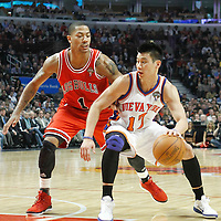 12 March 2012: New York Knicks point guard Jeremy Lin (17) drives past Chicago Bulls point guard Derrick Rose (1) during the Chicago Bulls 104-99 victory over the New York Knicks at the United Center, Chicago, Illinois, USA.
