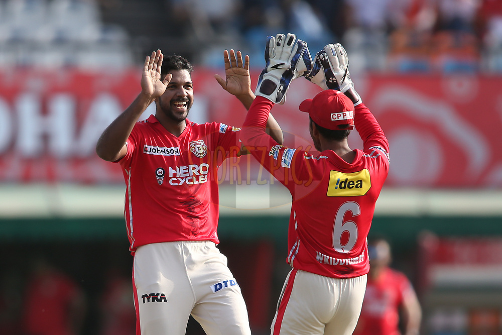 Varun Aaron of Kings XI Punjab is congratulated by Wriddhiman Saha of Kings XI Punjab for bowling Corey Anderson of the Delhi Daredevils during match 36 of the Vivo 2017 Indian Premier League between the Kings XI Punjab and the Delhi Daredevils held at the Punjab Cricket Association IS Bindra Stadium in Mohali, India on the 30th April 2017<br /> <br /> Photo by Shaun Roy - Sportzpics - IPL