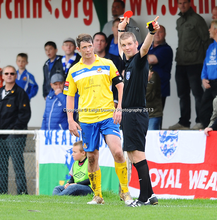 Referee Ian Fissenden awards a red card, sending off Sean Cronin (Captain) of Wealdstone after a foul. AFC Hornchurch v Wealdstone at The Stadium, Bridge Avenue, Upminster, Essex. FA Cup 3rd Qualifying Round. 12th October 2013. © Leigh Dawney Photography 2013.