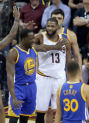 The Cleveland Cavaliers' Tristan Thompson (13) and the Golden State Warriors' Draymond Green exchange words in the first quarter during Game 4 of the NBA Finals at Quicken Loans Arena in Cleveland on Friday, June 9, 2017. (Photo by Phil Masturzo/Akron Beacon Journal/TNS) *** Please Use Credit from Credit Field ***