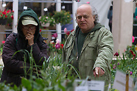 "Neighborhood residents came out in the pouring rain this past Friday, May 19th and Saturday May 20th, 2017 to the Hyde Park Garden Fair, Chicago's oldest community garden sale. The event was held in the courtyard of the Hyde Park Shopping Center located on the corner of 55th and Hyde Park Blvd.<br /> <br /> 4210 – Organizers, Louise Mcurry and George Rumsey discuss plants that are for sale.<br /> <br /> Please 'Like' ""Spencer Bibbs Photography"" on Facebook.<br /> <br /> All rights to this photo are owned by Spencer Bibbs of Spencer Bibbs Photography and may only be used in any way shape or form, whole or in part with written permission by the owner of the photo, Spencer Bibbs.<br /> <br /> For all of your photography needs, please contact Spencer Bibbs at 773-895-4744. I can also be reached in the following ways:<br /> <br /> Website – www.spbdigitalconcepts.photoshelter.com<br /> <br /> Text - Text ""Spencer Bibbs"" to 72727<br /> <br /> Email – spencerbibbsphotography@yahoo.com"
