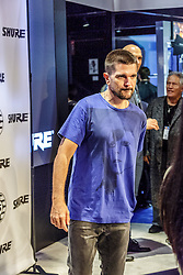 ANAHEIM, CA - JANUARY 21: Colombian mega star Juanes poses with fans during his meet and greed at NAMM 2017 in Anaheim, California USA on January 21, 2017. Byline, credit, TV usage, web usage or linkback must read SILVEXPHOTO.COM. Failure to byline correctly will incur double the agreed fee. Tel: +1 714 504 6870.