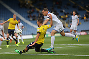 Oxford United midfielder Kemar Roofe (4) crosses the ball during the Sky Bet League 2 match between Oxford United and AFC Wimbledon at the Kassam Stadium, Oxford, England on 10 October 2015.