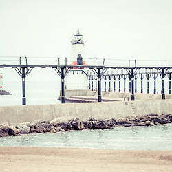 Michigan City lighthouse retro panorama picture. The Michigan City East Pierhead Lighthouse is located in Michigan City, Indiana along the Lake Michigan shoreline. Retro photo has vintage 1960s tone. Panoramic photo ratio is 1:3.