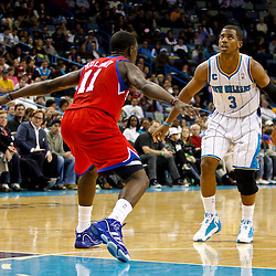 January 3, 2011; New Orleans, LA, USA; New Orleans Hornets point guard Chris Paul (3) is guarded by Philadelphia 76ers point guard Jrue Holiday (11) during the fourth quarter at the New Orleans Arena. The Hornets defeated the 76ers 84-77.  Mandatory Credit: Derick E. Hingle
