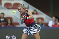 BEIJING, Oct. 3, 2018  Timea Babos of Hungary hits a return during the women's singles second round match against Zhang Shuai of China at China Open tennis tournament in Beijing, China, Oct. 3, 2018. Timea Babos lost 0-2. (Credit Image: © Song Yanhua/Xinhua via ZUMA Wire)