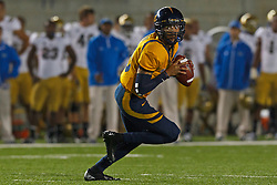 BERKELEY, CA - OCTOBER 06: Quarterback Zach Maynard #15 of the California Golden Bears scrambles out of the pocket against the UCLA Bruins during the second quarter at California Memorial Stadium on October 6, 2012 in Berkeley, California. The California Golden Bears defeated the UCLA Bruins 43-17. (Photo by Jason O. Watson/Getty Images) *** Local Caption *** Zach Maynard